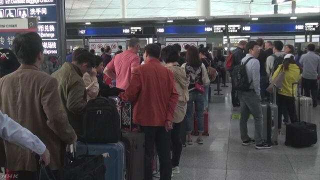 中国 国慶節の大型連休前に出国ラッシュ始まる