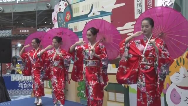 中国の広州で日本の観光と食べ物を紹介するイベント